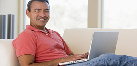 Adult man using laptop