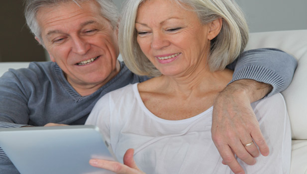 Older adult couple learning about a tablet and ereaders