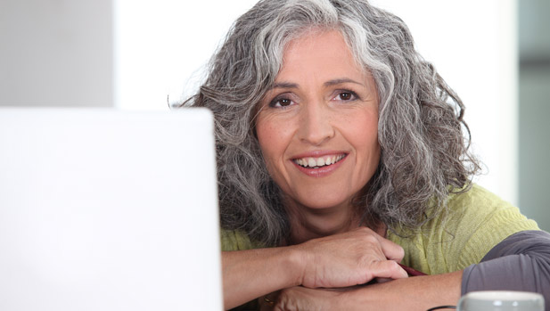 Woman smiling and happy with the money she saved now that she can shop and compare online